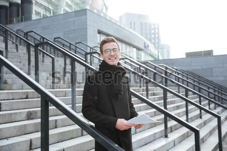 Businessman standing outdoors near business center Stock photo © deandrobot