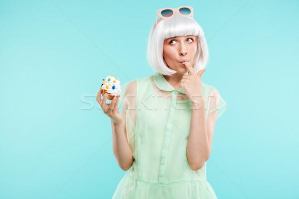 Funny stehen Verkostung Cupcake Stock foto © deandrobot