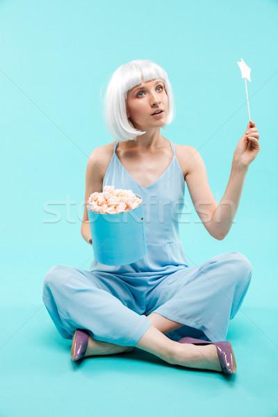 Teljes alakos fiatal nő varázspálca aranyos ül nő Stock fotó © deandrobot