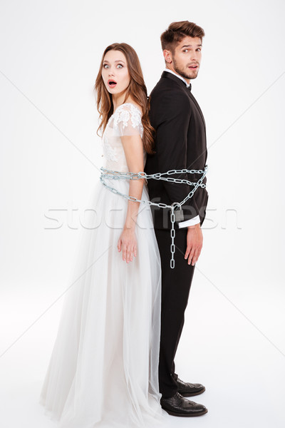 Full lenght portrait of couple with chaine Stock photo © deandrobot