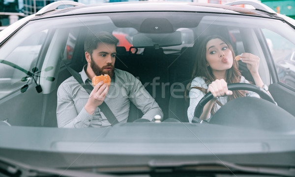 Front view of funny couple in car Stock photo © deandrobot