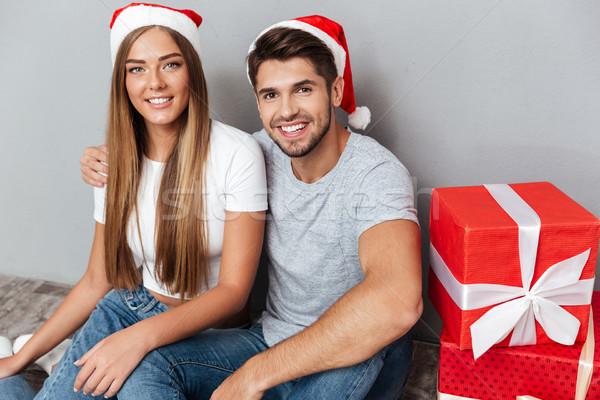 Christmas couple near gifts Stock photo © deandrobot