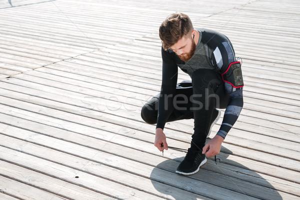 Top view of young runner preparing near the sea Stock photo © deandrobot