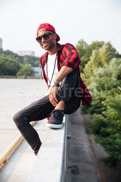 Derűs sötét férfi visel napszemüveg természet Stock fotó © deandrobot