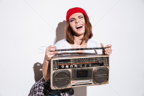 Young pretty lady holding tape recorder. Stock photo © deandrobot