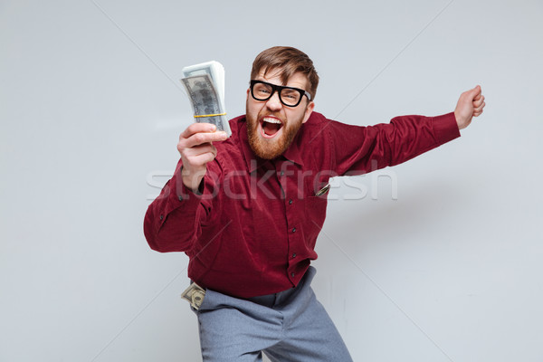 So Happy Male nerd with money in hand Stock photo © deandrobot