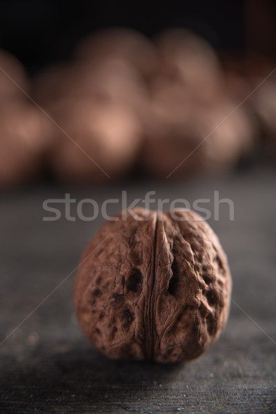 Walnut over dark background Stock photo © deandrobot