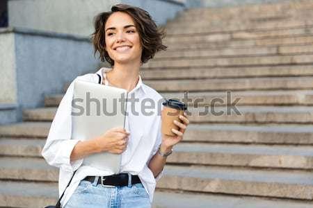 Donna sorridente piedi scale cappotto Cup Foto d'archivio © deandrobot