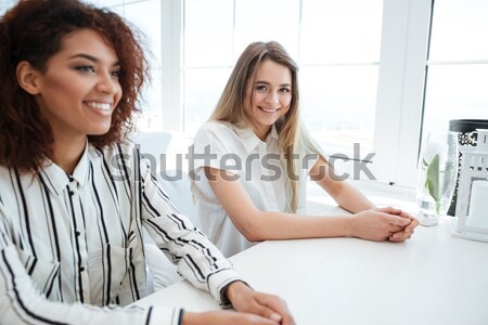 Side view of two women sitting in cafe Stock photo © deandrobot
