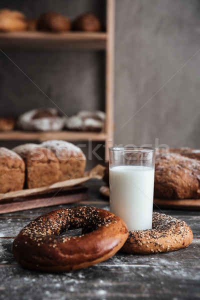 Pastries on dark wooden table and bread on background Stock photo © deandrobot