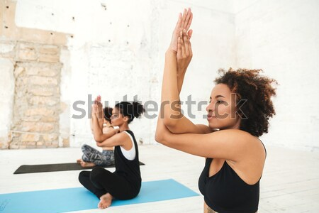 Youg african man and redhead man making exercises in gym Stock photo © deandrobot