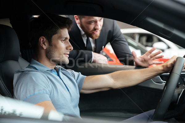 Professional male dealer selling car to a customer Stock photo © deandrobot