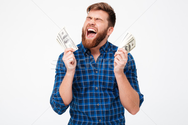 Screaming bearded man in checkered shirt holding money in hand Stock photo © deandrobot
