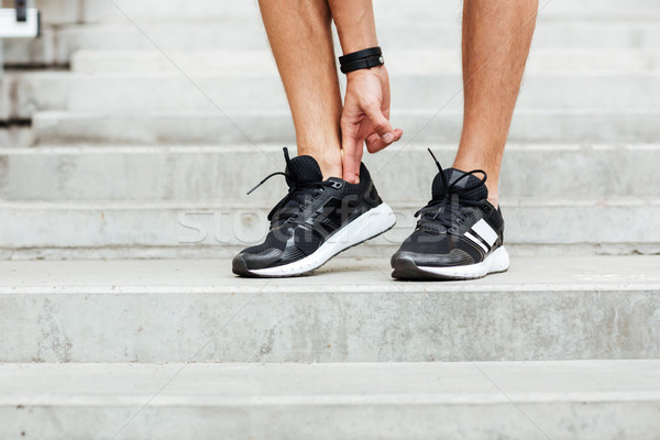 Cropped image of young sports man footwear Stock photo © deandrobot
