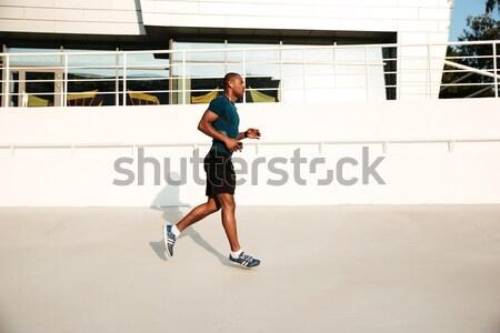 Teljes alakos portré férfi futó sportruha fiatalember Stock fotó © deandrobot