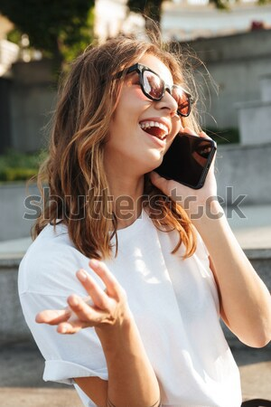 Close up portrait of a pretty young girl in sunglasses Stock photo © deandrobot