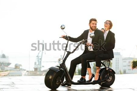 Pleased stylish couple rides on modern motorbike outdoors Stock photo © deandrobot