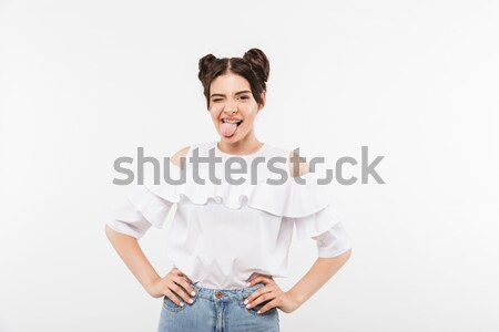 Smiling young man pointing to you. Looking camera. Stock photo © deandrobot