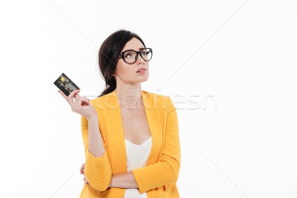 Portret aantrekkelijk peinzend vrouw bril Stockfoto © deandrobot