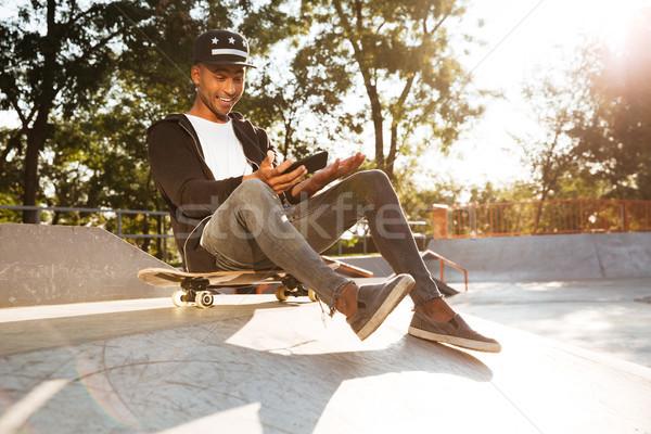 портрет афро американский парень скейтбордист Сток-фото © deandrobot