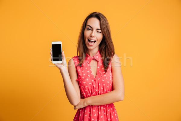 Zufrieden Brünette Frau Kleid Smartphone Stock foto © deandrobot