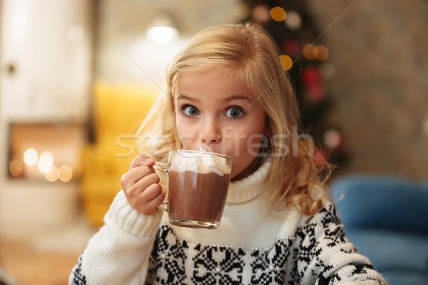 красивой мало блондинка девушки питьевой какао Сток-фото © deandrobot
