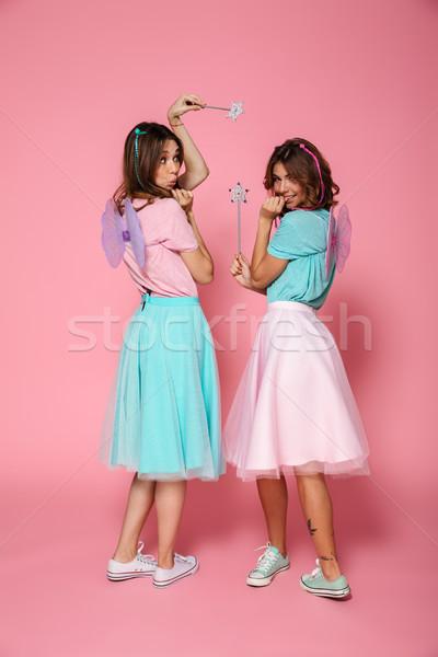 Tam uzunlukta portre iki gülen mutlu kızlar Stok fotoğraf © deandrobot