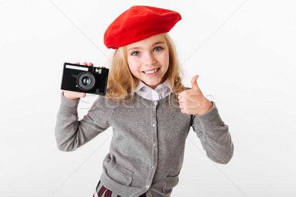 Retrato satisfeito pequeno aluna uniforme Foto stock © deandrobot