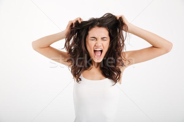 Ritratto pazza ragazza capelli fuori Foto d'archivio © deandrobot