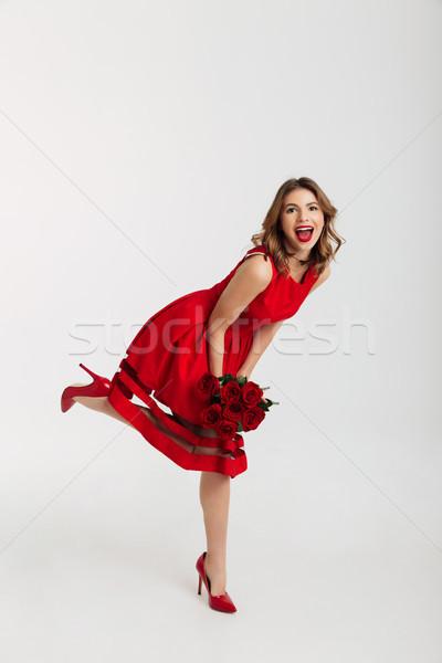 Tam uzunlukta portre mutlu genç kadın kırmızı elbise Stok fotoğraf © deandrobot