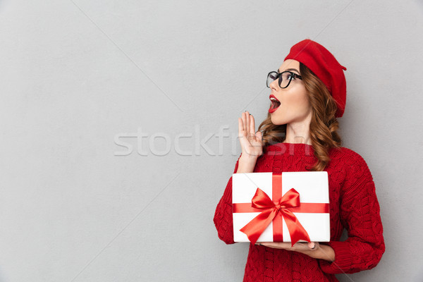 Portrait of an astonished woman dressed in red sweater Stock photo © deandrobot