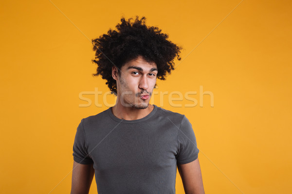 Portrait of a funny young afro american man Stock photo © deandrobot