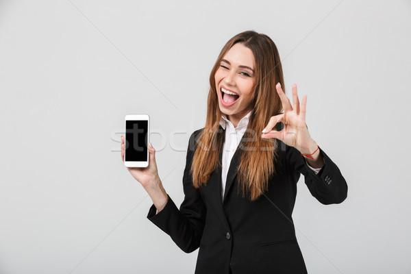 удивленный Lady вызывать жест смартфон Сток-фото © deandrobot