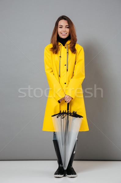 Teljes alakos portré boldog lány esőkabát gumicsizma áll Stock fotó © deandrobot
