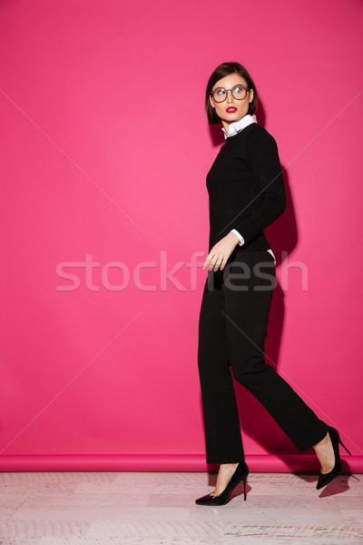 Teljes alakos portré fiatal vonzó üzletasszony pózol Stock fotó © deandrobot