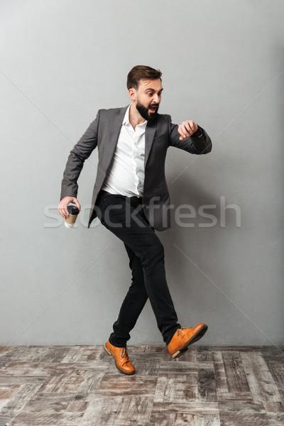 Obraz człowiek kawy patrząc oglądać późno Zdjęcia stock © deandrobot