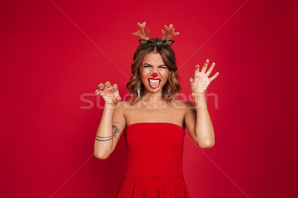 Portrait of a cute young girl wearing christmas deer costume Stock photo © deandrobot