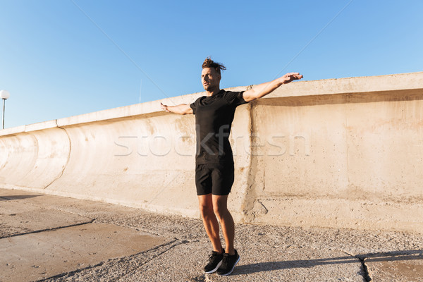 Portré fókuszált sportoló ugrik kint reggel Stock fotó © deandrobot