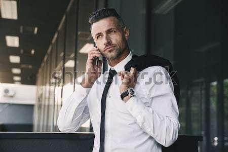 Portré sikeres fiatal üzletember hivatalos ruházat Stock fotó © deandrobot