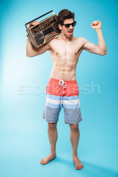 Portret wesoły półnagi człowiek pływanie Zdjęcia stock © deandrobot