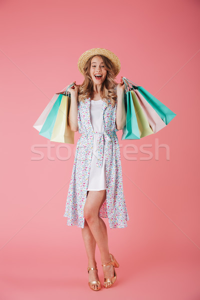 Stock photo: Full length portrait of a cheerful young woman