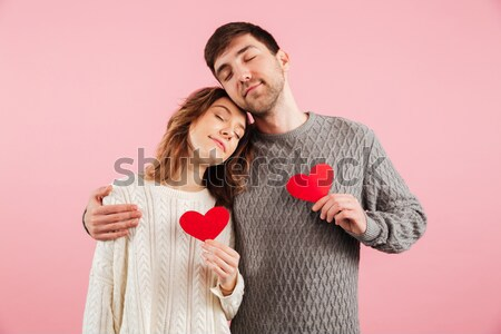 Portrait of young smiling couple man and woman in basic clothing Stock photo © deandrobot