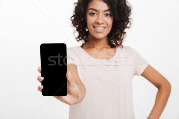 Mooie vrouw afro bruin haar commerciële presenteren nieuwe Stockfoto © deandrobot