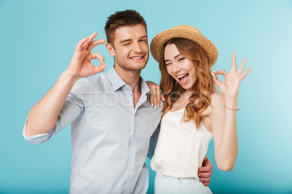 Happy caucasian people man and woman showing okay gesture. Stock photo © deandrobot