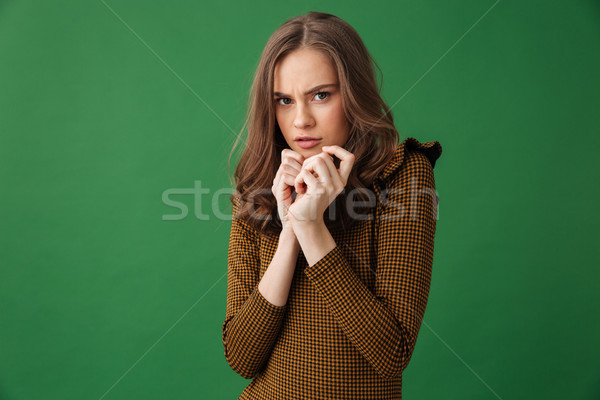 Scared young woman looking camera. Stock photo © deandrobot