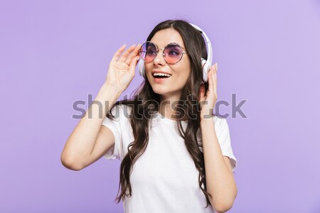 Portrait of a positive young girl Stock photo © deandrobot