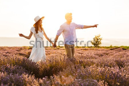 Photo of happy young man and woman dating, and walking together  Stock photo © deandrobot