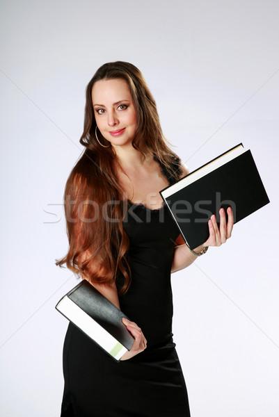 Szczęśliwy kobieta stałego książek szary Zdjęcia stock © deandrobot