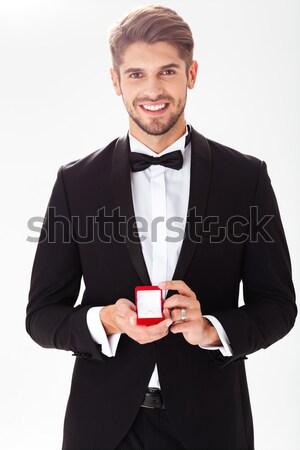Businessman giving money isolated on white background Stock photo © deandrobot