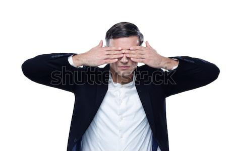 Businessman put his hands over eyes isolated on a white background Stock photo © deandrobot
